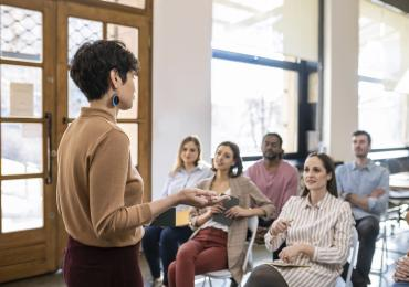 Woman leading group discussion