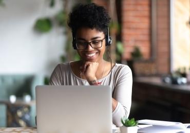 Woman watching a webinar