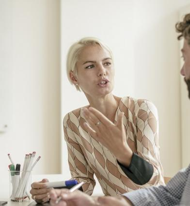 Woman in discussion with man